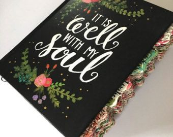 Each bible cover is hand painted at the time you order. If you have a specific color scheme, quote or scripture you prefer we can work together to make it just the way you want.  This Bible Bundle includes: -ESV black cover journal Bible that has been hand painted to your specifications -64 handwritten tabs (1,2 & 3rd John are on one tab) there are 4 different tab patterns available. -10 blank tabs to add yourself when you want to mark certain subjects youve studied. - 9 journaled art…
