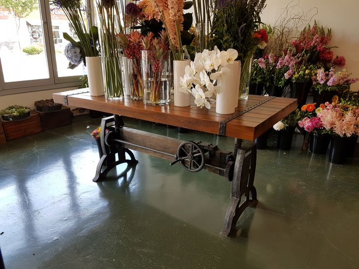 Our IND134 Industrial Adjustable Cast Iron Base Crank Table being put to good use in our customer's store! Check out our website to get your very own!
