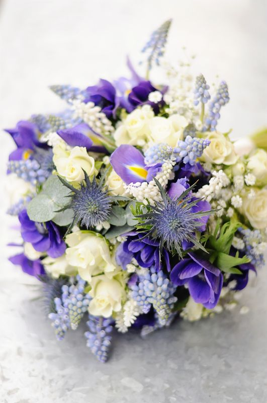 What do you all think of this iris and Muscari bridal bouquet? We thinks it's divine!