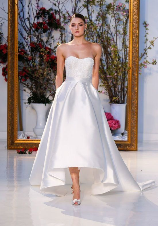 c201af5555 Strapless high-low gown of Mikado with beaded lace appliqués on bodice and  skirt with pockets