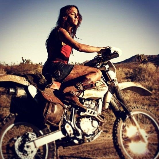 hot naked babe riding a dirtbike