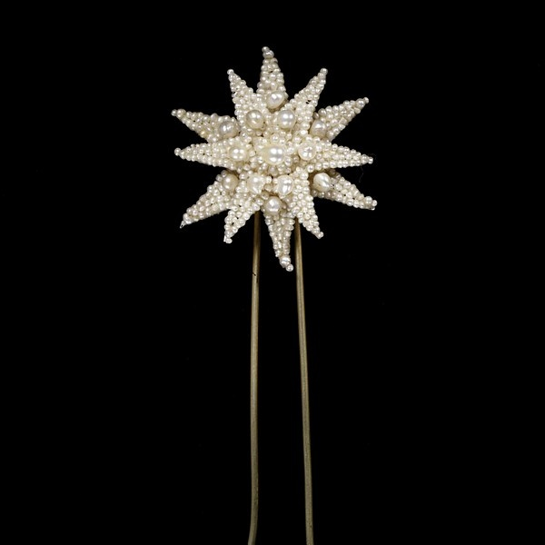 "c1815 Regency era Hair pin. Hair pin, seed pearls mounted on mother-of-pearl. These long, tong, U shaped pins were functional as well as decorative.  These would have been used in conjunction with plain pins for added support to the ""updo"" styles of the day. These are thicker and longer than the hair pins and bobby pins normally found today. See what the back looks like at http://collections.vam.ac.uk/item/O115271/hair-pin-unknown/"