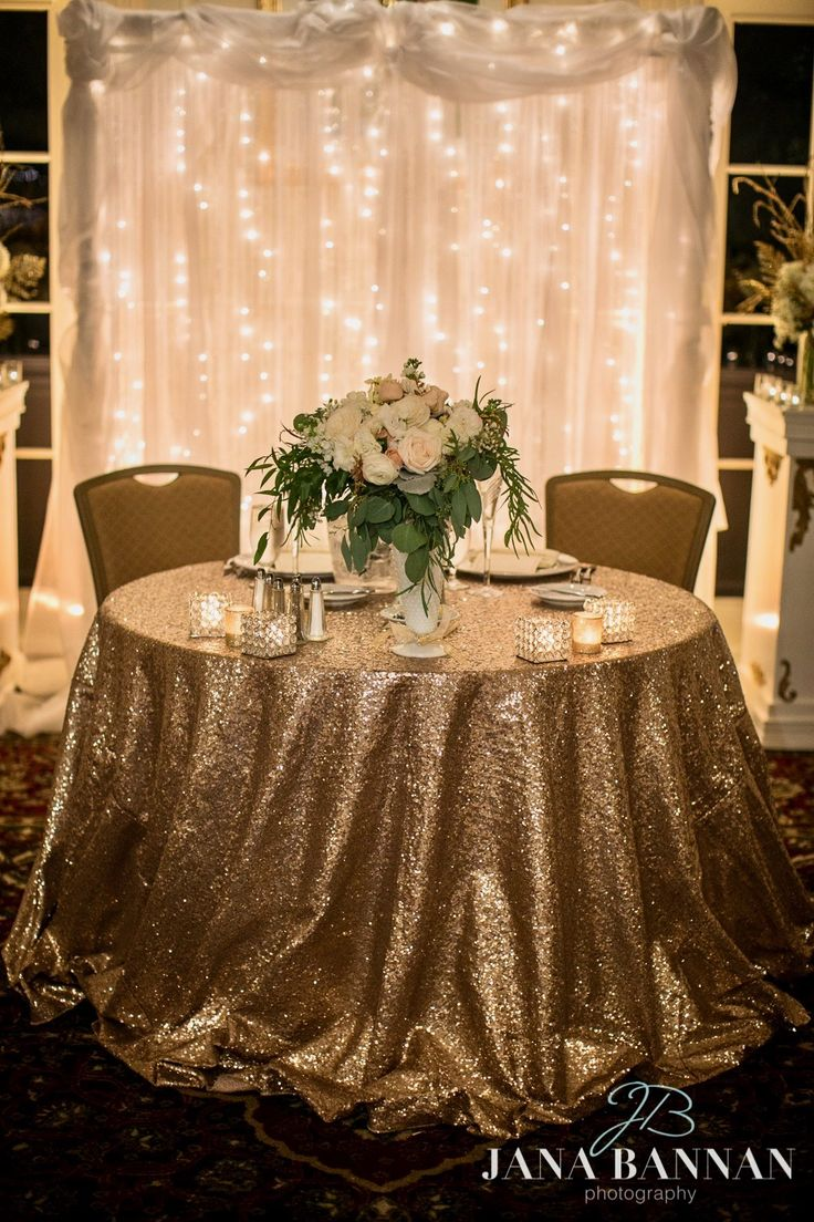 Trend-setting gold glitz and shimmering illumination for the bride and groom at Deerfield Golf Club.