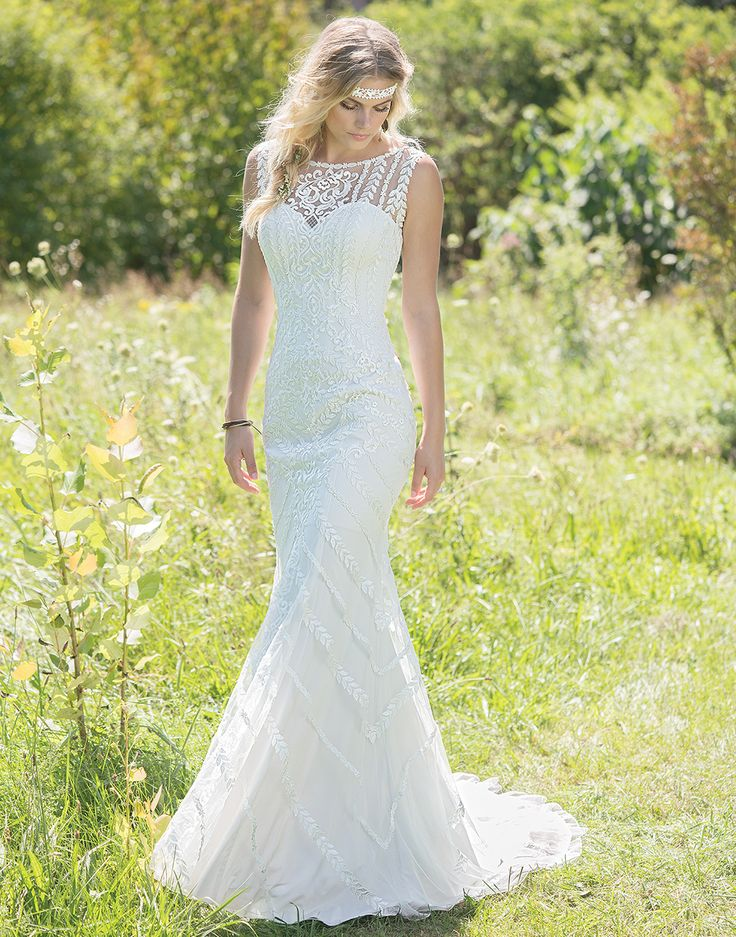 Lillian West 6478 Sand/Ivory Size 10 Neither comfort nor style are compromised in this fit and flare gown. Jersey-lined for maximum movement with hand-placed lace and stunning scoop back make this ultra-flattering style perfect for the free-spirited bride.  https://www.lillianwest.com/lillian_west/6478