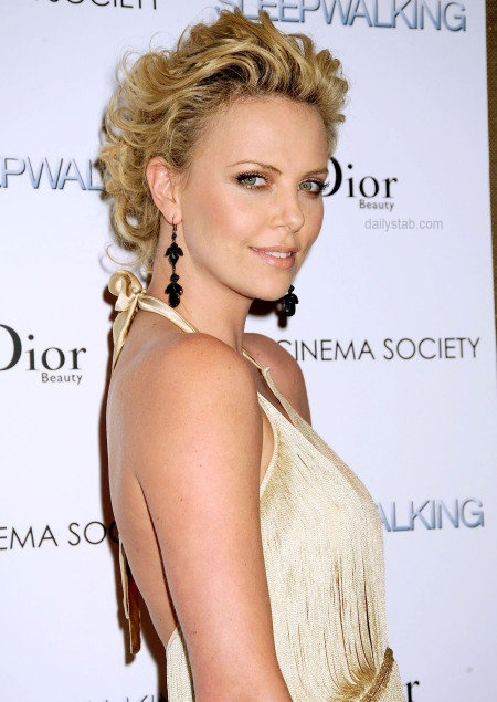 Love this hairstyle on Charlize Theron
