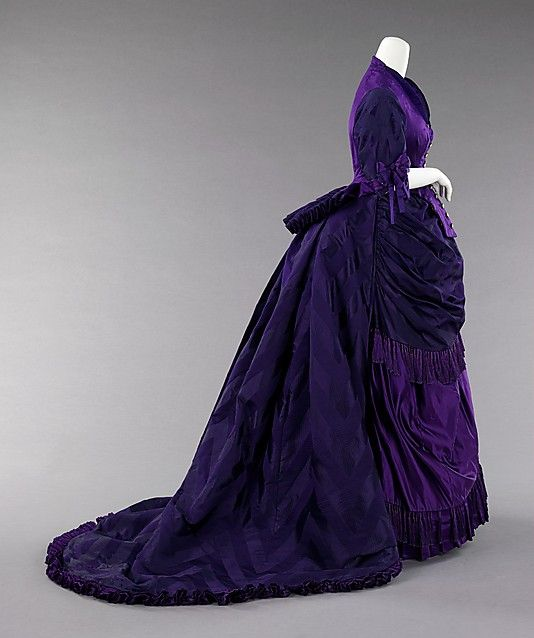 Purple silk brocade evening gown by Charles Worth, circa 1872. Brooklyn Museum Costume Collection.
