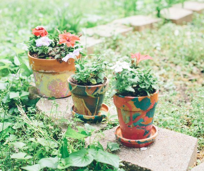 Make your own DIY planters with colorful nail polish marbling. A simple technique creates unique and colorful designs for your flower pots.
