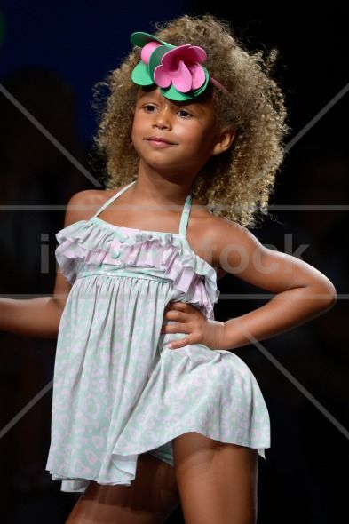 Kids Fashion Show Swimwear quot A child model walks the