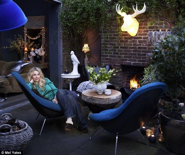 Abigail Ahern enjoying her cosy outdoor living space. More #blue goodness on the RSD Blog.