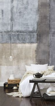 Exposed cement walls and plush bedding are a striking contradiction that works so well.