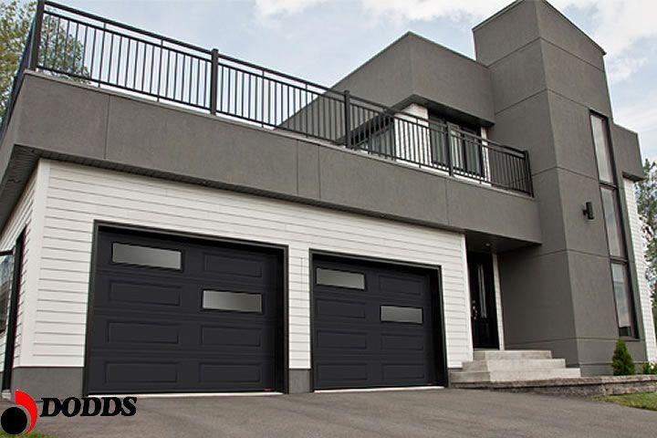 Contemporary Window Design Makes This Steel Garage Door Fit The Modern Home Garage Doors Modern Garage Doors Garage Door Styles
