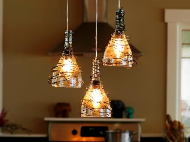 DIYNetwork.com has instructions on how to make pendant lights from old wine bottles. I would wrap the tops of the bottles with fabric scraps or rope to hide them.