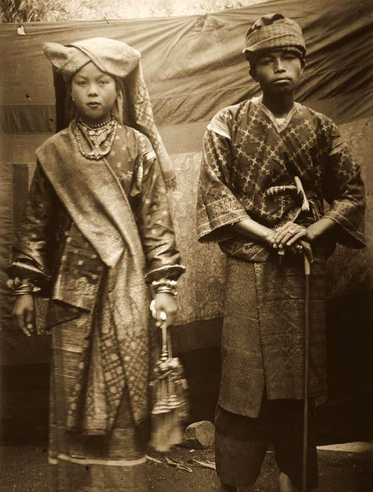 Indonesia | A Minangkabau couple from West Sumatra dressed in ceremonial finery. ca. 1930