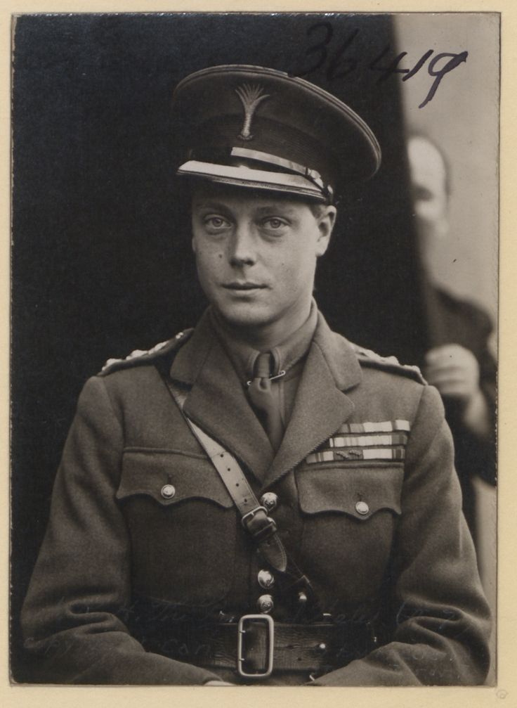 A royal photobomb. This is Edward VIII (Prince of Wales) in 1919. That other guy is the photographer's assistant.