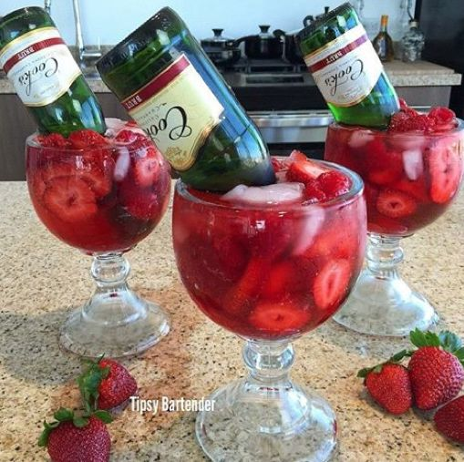 The Drunk in Love Cocktail by Tipsy Bartender  2 oz. Smirnoff Strawberry Vodka. 1 oz. Triple Sec, 1/2 oz. Grenadine, 2 oz. Strawberry Daiquiri. Mix Cook's Brut Small Champagne Bottle Raspberries/Strawberries  https://www.youtube.com/watch?v=92EooCtQPF4&feature=youtu.be
