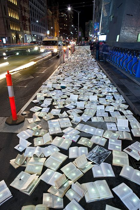 """Over 10,000 books thrown out by public libraries were recently given new life in a beautiful new lighting installation by Inhabitat favorites Luzinterruptus. Called """"Literature Versus Traffic."""""""