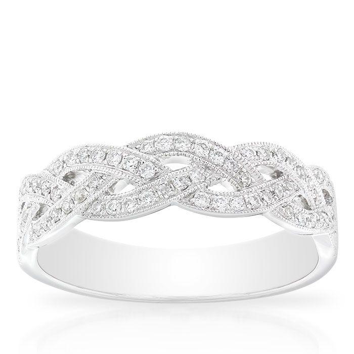 Braid design diamond ring, 1/4 carat total weight, in 14K white gold.