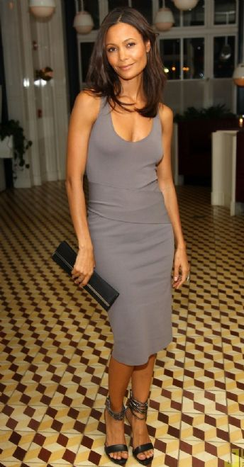 Simple, body-hugging grey dress with simple black sandals