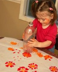 Paint the bottom of 2 liter bottle and press on paper to make flowers.