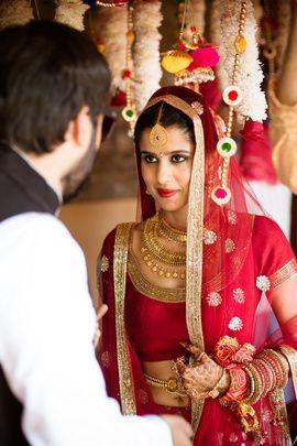 Bridal Details - Red Bridal Lehenga with Gold Jewelry   WedMeGood   Red Bridal Lehenga with Net Dupatta and a Gold Waistbelt  #wedmegood #indianbride #indianwedding #red #bridal #lehenga #gold