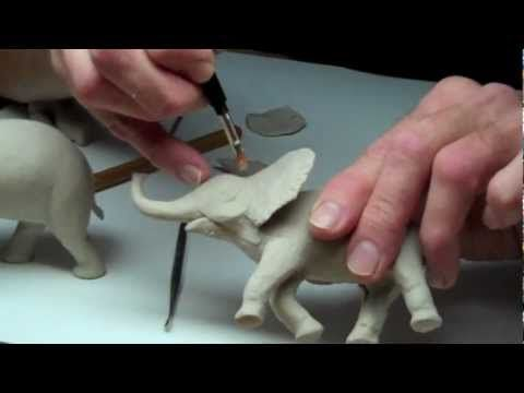 Learn clay sculpture with professional sculptor Chuck Oldham at http://www.LearnSculpture.org. This is Lesson 3, Part 3, sculpting animals (a baby elephant) ...