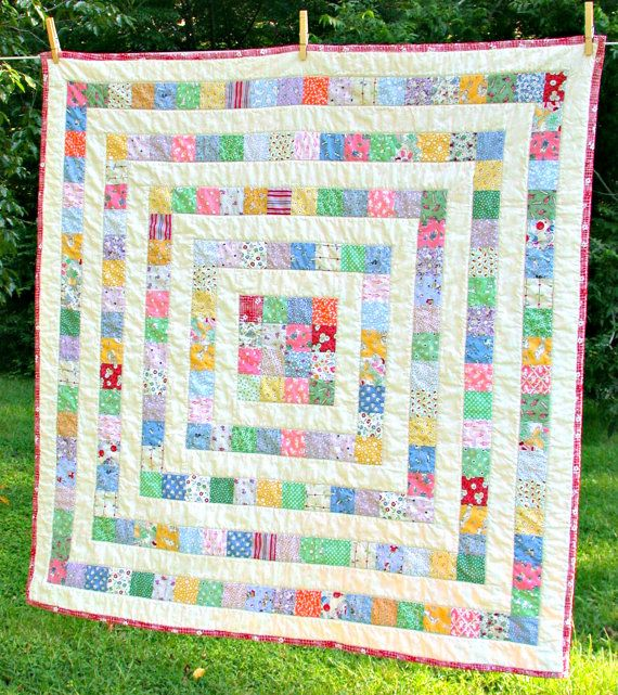 This scrappy quilt is made from a medley of 1930s feedsack reproduction fabrics. These fabrics combined with the muslin sashing really give it that vintage look. What I love so much about the reproduction fabrics is the comforting homey-ness that they convey. This quilt measures 44 x44 inches. Its a generous size for keeping baby warm and cozy and as baby grows into a toddler, theres still plenty of snuggle room. Its sized large enough for an adult to use as a lap quilt when nestling up with…