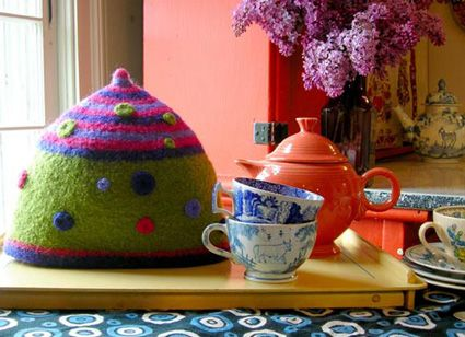 The book Colorful Stitchery, has directions for a super cute tea cosy felted from a wool blanket.