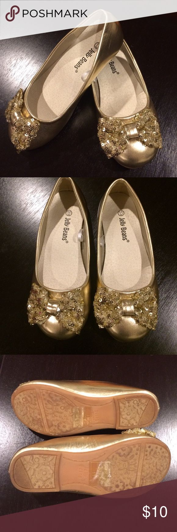 Girls Gold Flats Great Condition girls gold ballet flats, size 11 by Jelly Beans. Bow on front toe is gold sequins. Jelly Beans Shoes Dress Shoes