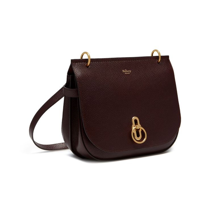Shop the Amberley Satchel in Oxblood Natural Leather at Mulberry.com. Inspired by British countryside pursuits, the Amberley gets its ring hardware and satchel shape from traditional equestrian styling. This smaller satchel features a geometrical rider's lock closure in brass hardware, inspired by and reinterpreting the centre of the iconic postman's lock. Inside it is luxuriously finished with a suede lining. Multi-functional, it can be worn over the shoulder or across body.