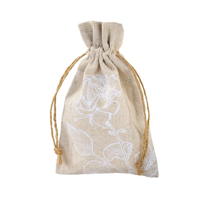 These vintage in style bags make great vintage wedding and celebration favours.  A mix of linen and cotton with a white print floral design.  14x9cm pack of 4 £5.50 by www.fuschiadesigns.co.uk