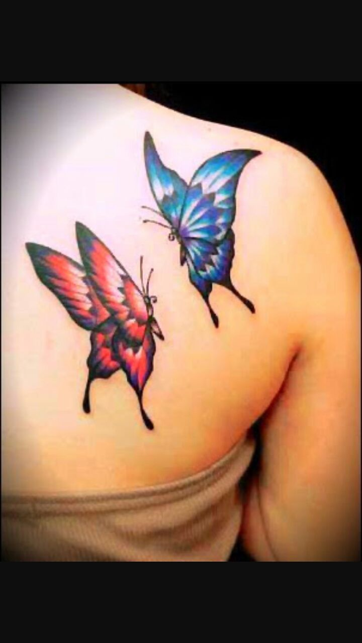 Red And Blue Two Flying Butterflies Tattoo On Girl Back Shoulder