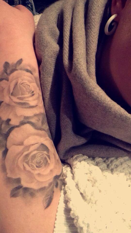 Faded rose tattoo