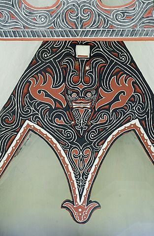 Detail of traditional Batak tribal painted carving with stylised buffalo horns, Huta Bolon, Simanindo, Sumatra, Indonesia, Southeast Asia, Asia