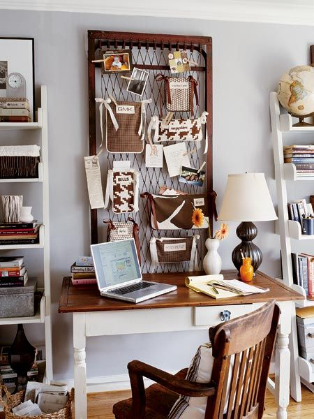 Create a stylish and functional space above your desk with an old cot frame or metal grate. Fabric scrap pockets hold everything from bills and recipes to photos. (Photo: Photo: Robbie Caponetto)