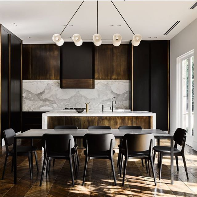 INTERIORS: Bronze, brass and a bold aesthetic for the kitchen of the Armadale Residence from @flackstudio, shot by @brookeholm and art direction by @marshagolemac. #estliving #armadaleresidencebyflackstudio #kitchendesign