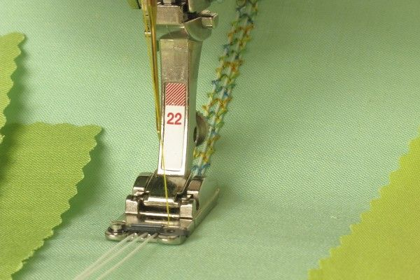 Use this tip with BERNINA Braiding Foot #22 to add a bit of glow to your sewing projects.