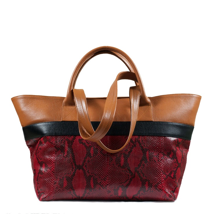 BOLDO Shopper Tote in Currant Python. With a short handle for holding by hand, and a long strap for wearing over the shoulder, this Boldo Shopper Tote is best worn doubled up with a smaller bag on a busy day. Roomy and adaptable, it's excellent for travelling and overnights, or for work and weekends. This Shopper Tote is lined in a faux suede for luxury hand-feel. AU$550