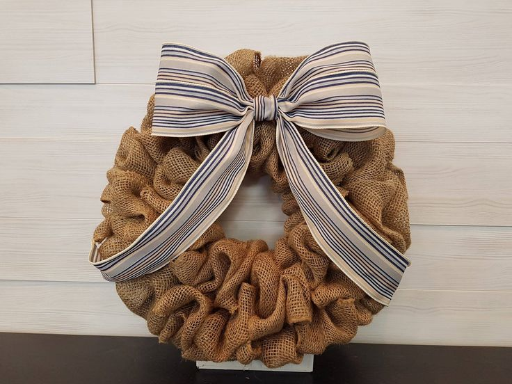 Burlap Wreath with Bow . . #goldenforrest #goldenforrestcreations #burlap #burlapwreath #handmade #wreathideas #frontdoordecor #bow #stripes #simple