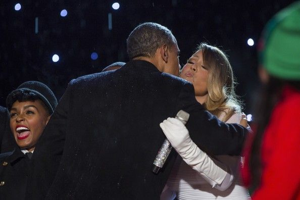 Mariah Carey Photos - U.S. President Barack Obama kisses performer Mariah Carey after she sang at the 91st national Christmas tree lighting ceremony on the Ellipse south of the White House December 6, 2013 in Washington, DC. The lighting of the tree is an annual tradition attended by the president and the first family. President Calvin Coolidge lit the first national Christmas tree, a 48-foot Balsam fir, in 1923. - First Family Attend National Christmas Tree Lighting