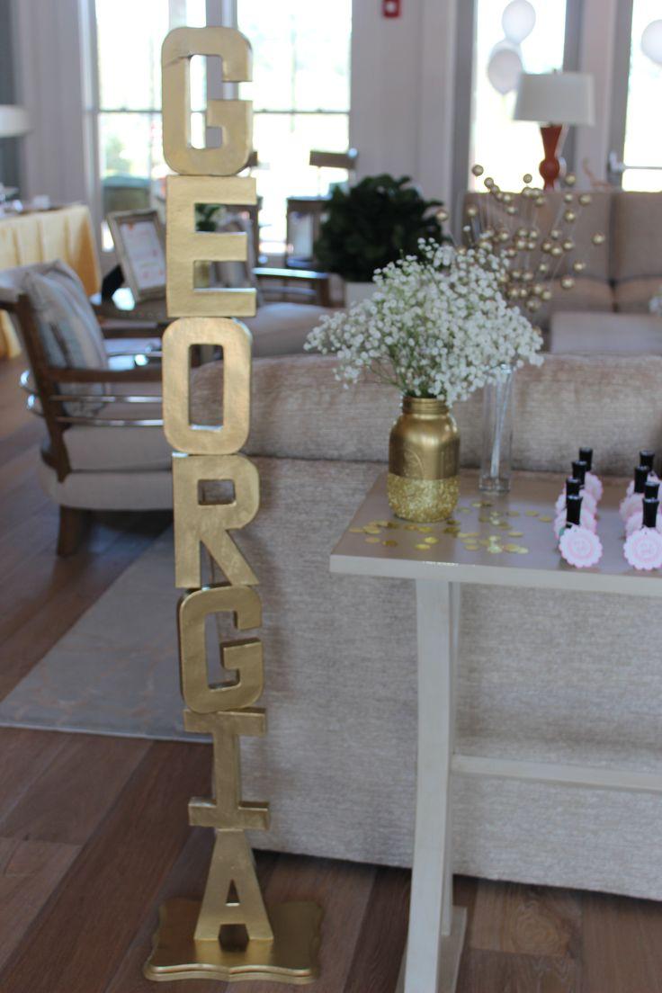 DIY: gold letter name stand  baby shower: pink, gold, mint http://mommyjmac.blogspot.com/2014/01/kellis-baby-shower-details.html
