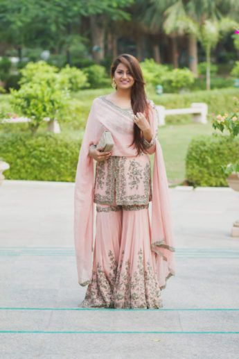 Indian Women Suits - Bride in a Soft Pink Sharara with Silver Embroidery on Borders | WedMeGood #wedmegood #indianbride #indianwedding #sharaha #indianwomensuits #suit #pink #bridal
