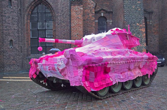 By Yarn Bombing [Guerrilla crochet street art, and a fair destiny for some war waste -is there anything in war which is not a waste?]
