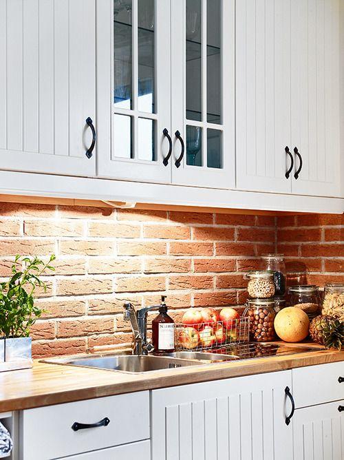 I like the wood countertop with the brick backsplash.