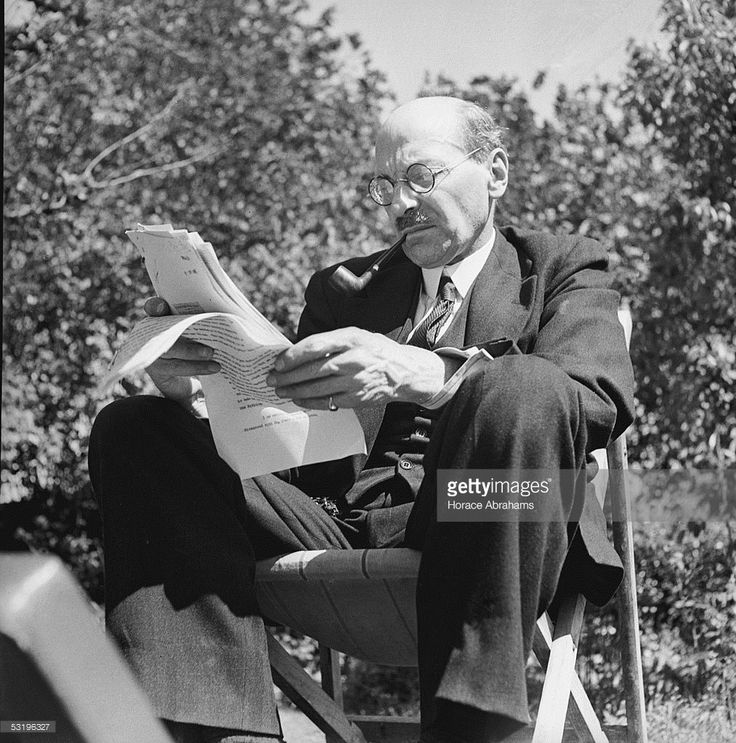 British Prime Minister Clement Attlee (1883 - 1967) studies a document in the garden at his home in Stanmore, Middlesex, 28th July 1945.