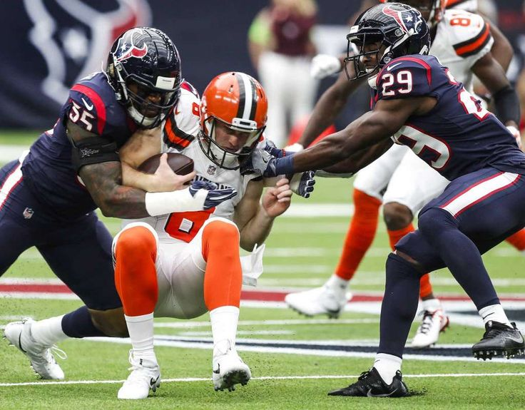 Houston Texans defensive back Eddie Pleasant (35) and  free safety Andre Hal (29) tackle Cleveland Browns quarterback Kevin Hogan (8) after he was force out of the pocket during the first quarter of an NFL football game at NRG Stadium on Sunday, Oct. 15, 2017, in Houston. Photo: Brett Coomer, Houston Chronicle / © 2017 Houston Chronicle
