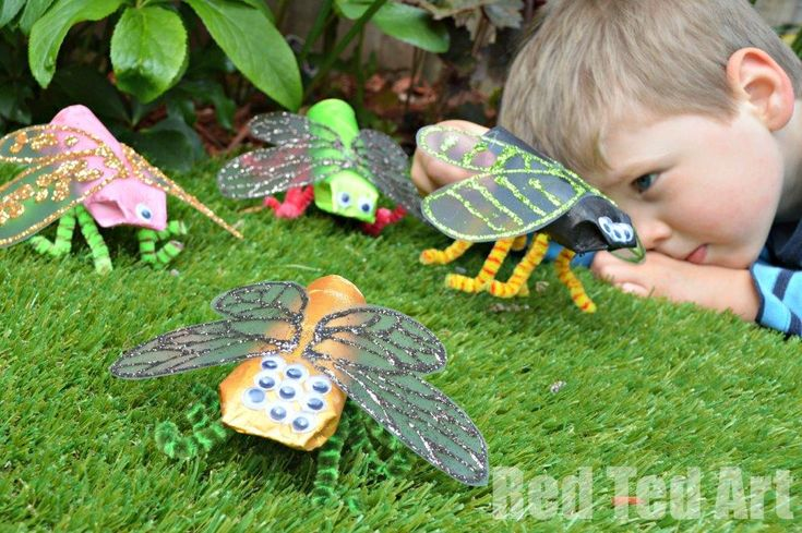 Mini Beast Crafts for kids.  Use tp rolls, acetate or clear folders for wings.  Draw design on wings with white glue and sprinkle on glitter.  Hot glue to body.  Very cool.