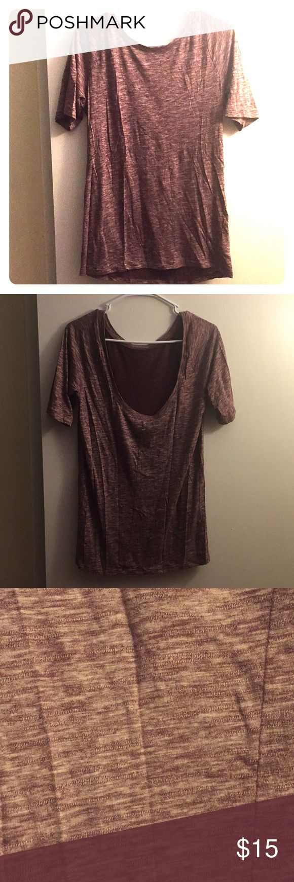 Gap sexy back tee This shirt needs way more love than I give it with a sexy ballet scoop in the back and a wonderful wine color. Soft and lightweight, looks great with a pair of shorts or destructed jeans. Size large but is a little more fitted style shirt, would easily fit as a medium. Worn only a few times. GAP Tops Tees - Short Sleeve