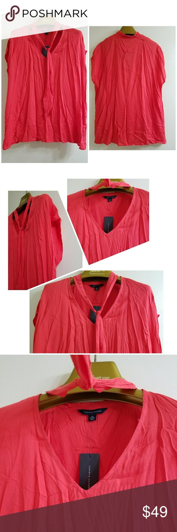 "NWT Tommy Hilfiger Women's Coral Casual Top Up for sale is this beautiful Tommy Hilfiger coral top. This top is brand new with tag. It is sleeveless, has a tie neck.  Kept in a smoke, pet- free environment.   Size: XL Color: Coral Fabric:   Lining:  Design:  Sleeves: Sleeveless Materials: 100% Viscose  Neckline: v-neck  Measurements (approximate)  Length: 27""  Underarm to underarm: 22 1/2""  Condition: New With Tags Tommy Hilfiger Tops Blouses"