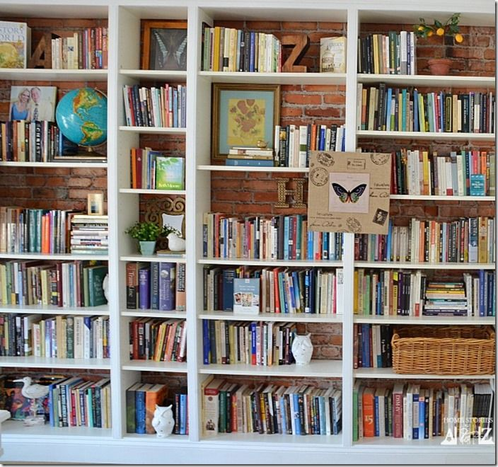 built in billy bookcases with brick behind it -could simulate this with wallpaper.
