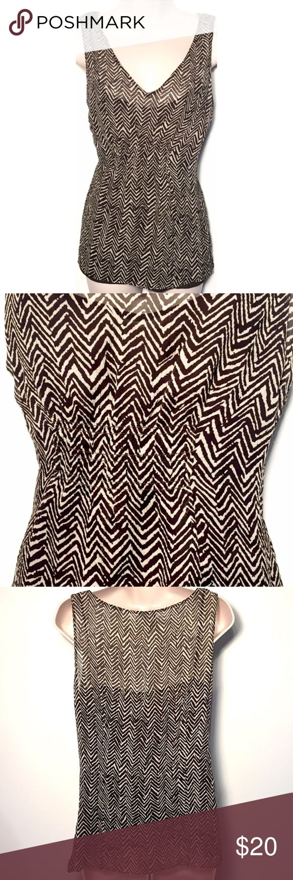 """❣BOGO 1/2 off❣Ann Taylor silk chevron sleeveless Flawless condition. Freshly dry cleaned. Built-in sheer brown camisole. Elastic under bust. Material has slight stretch. Side zip closure. Size 10. Approx 25"""" long & 19"""" flat across chest. ✖️I do NOT MODEL✖️ 🔴Bundle to save! 🔴NO TRADES. 🔴REASONABLE offers welcome via offer button. Ann Taylor Tops Tank Tops"""